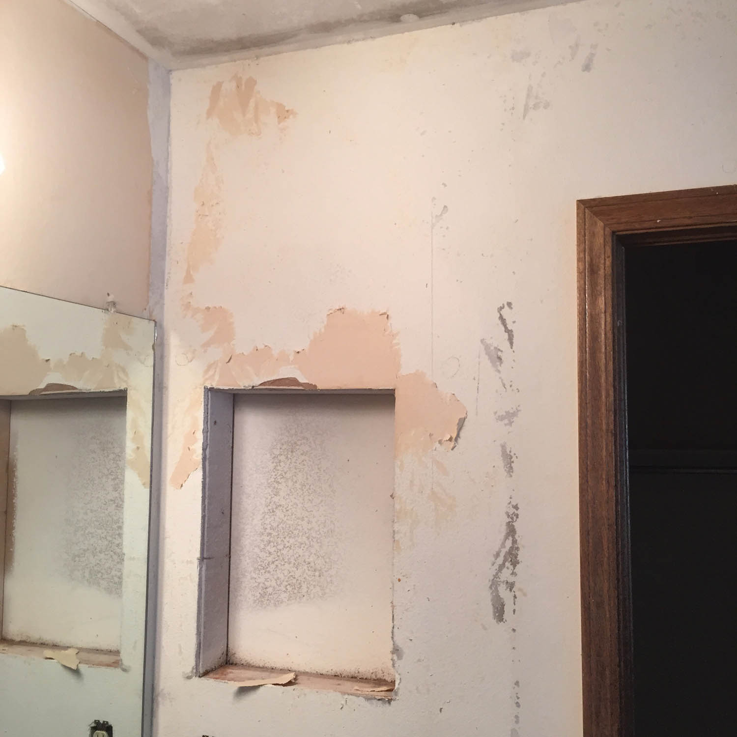 hole in the wall and wallpaper peeling