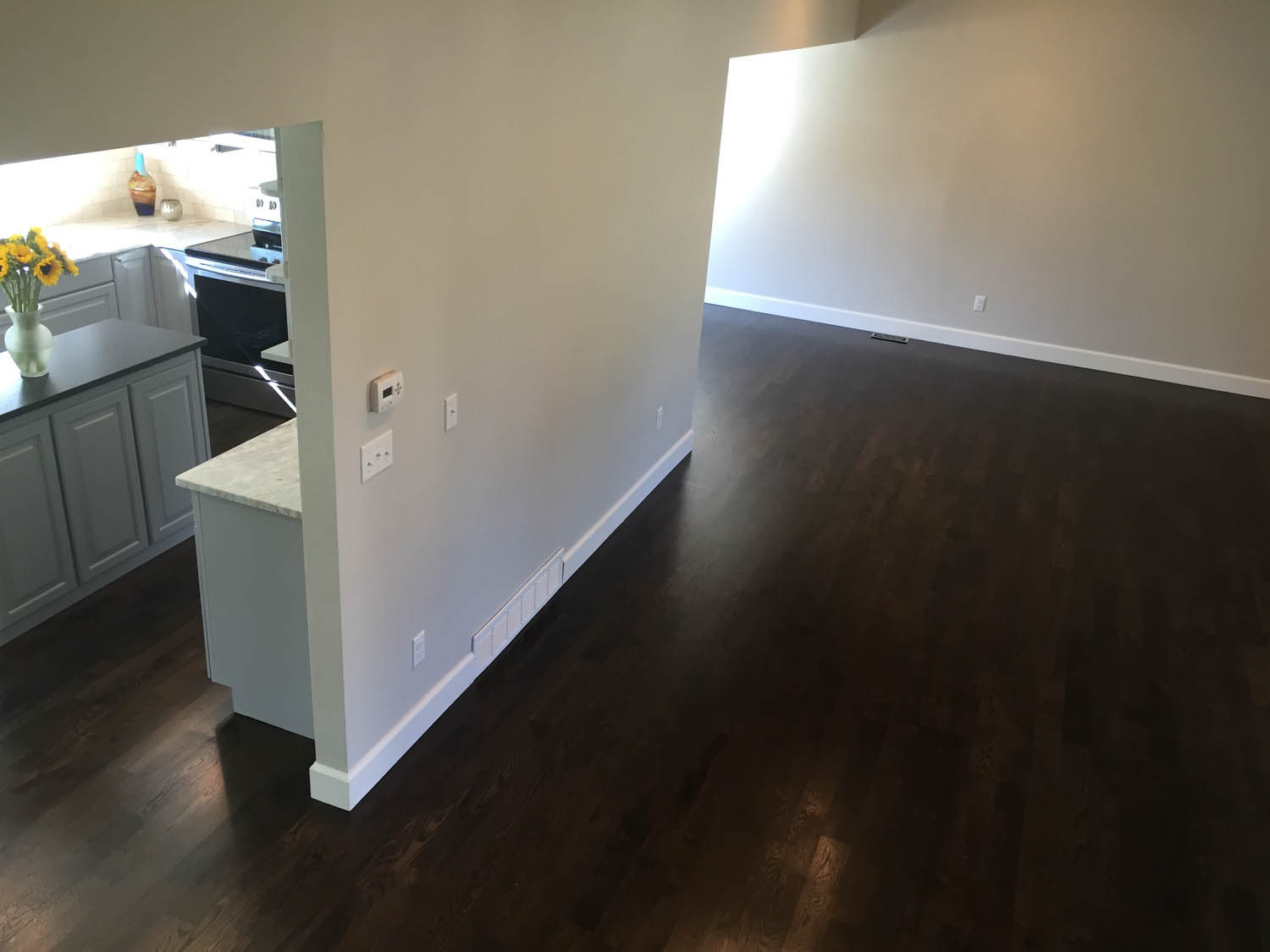 oak flooring with stained black finish