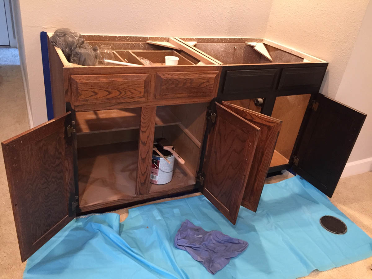 family room bar converted to storage cabinet being painted black for remodel