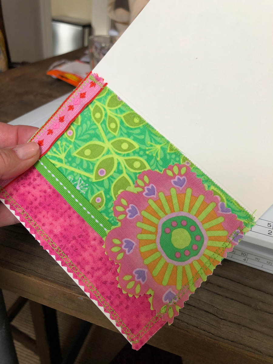 Close-up of fussy-cut fabric shape on hand-made embellished spring Easter card