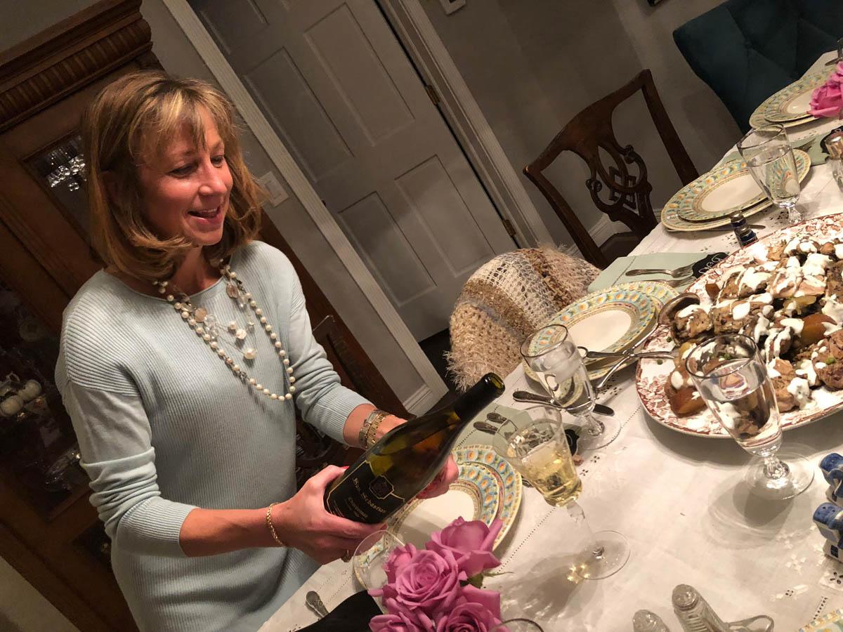 Ashley pouring san sebastian wine at table