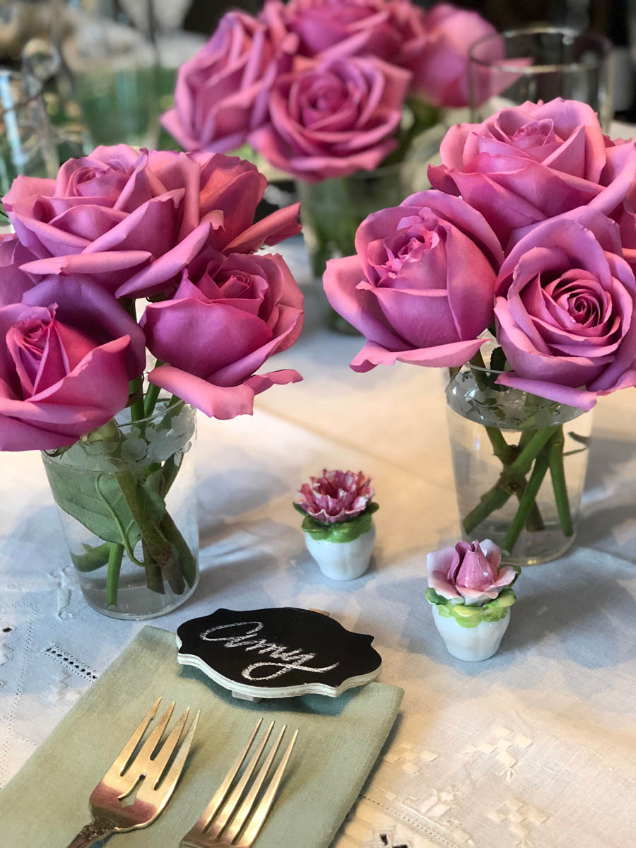 roses in vases at place settings with names