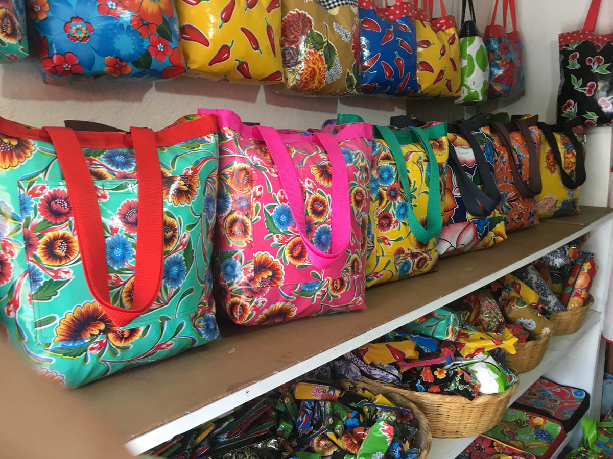 colorful vinyl fabric tote bags in boutique of San Miguel de Allende