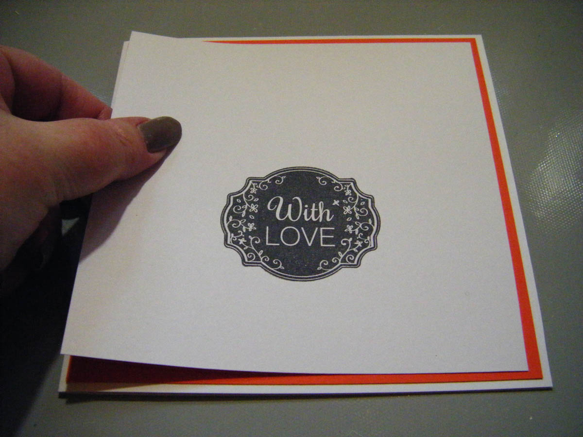 Layer the stamped card over its colored backing card