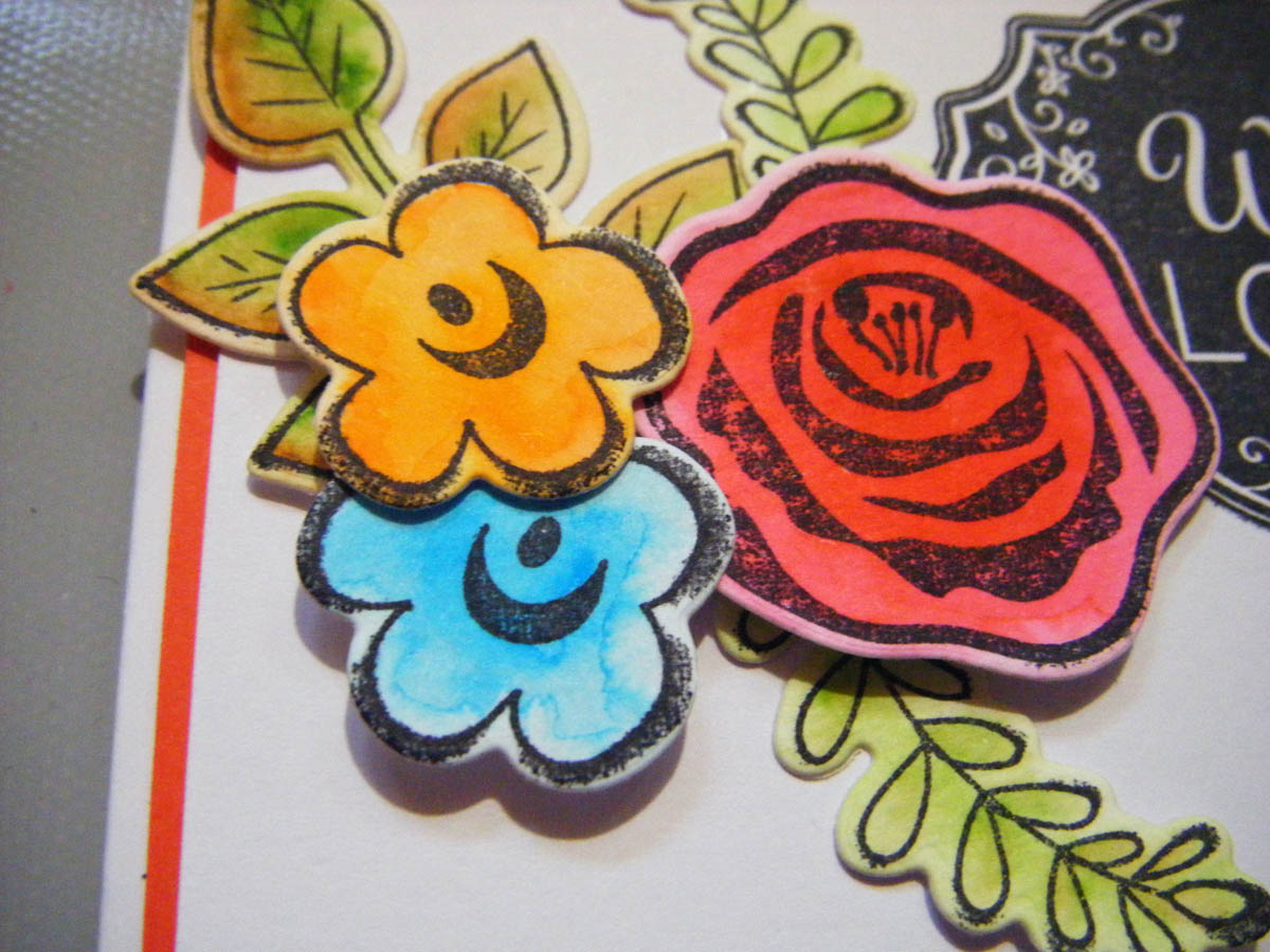 Add smaller colored die-cut flower shapes next to the large flowers