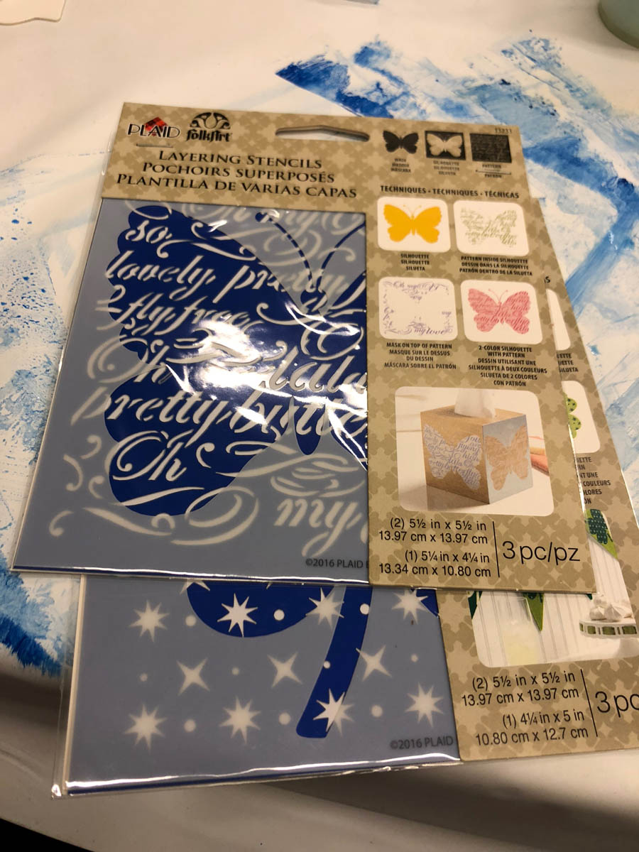 Layering stencils for travel journal