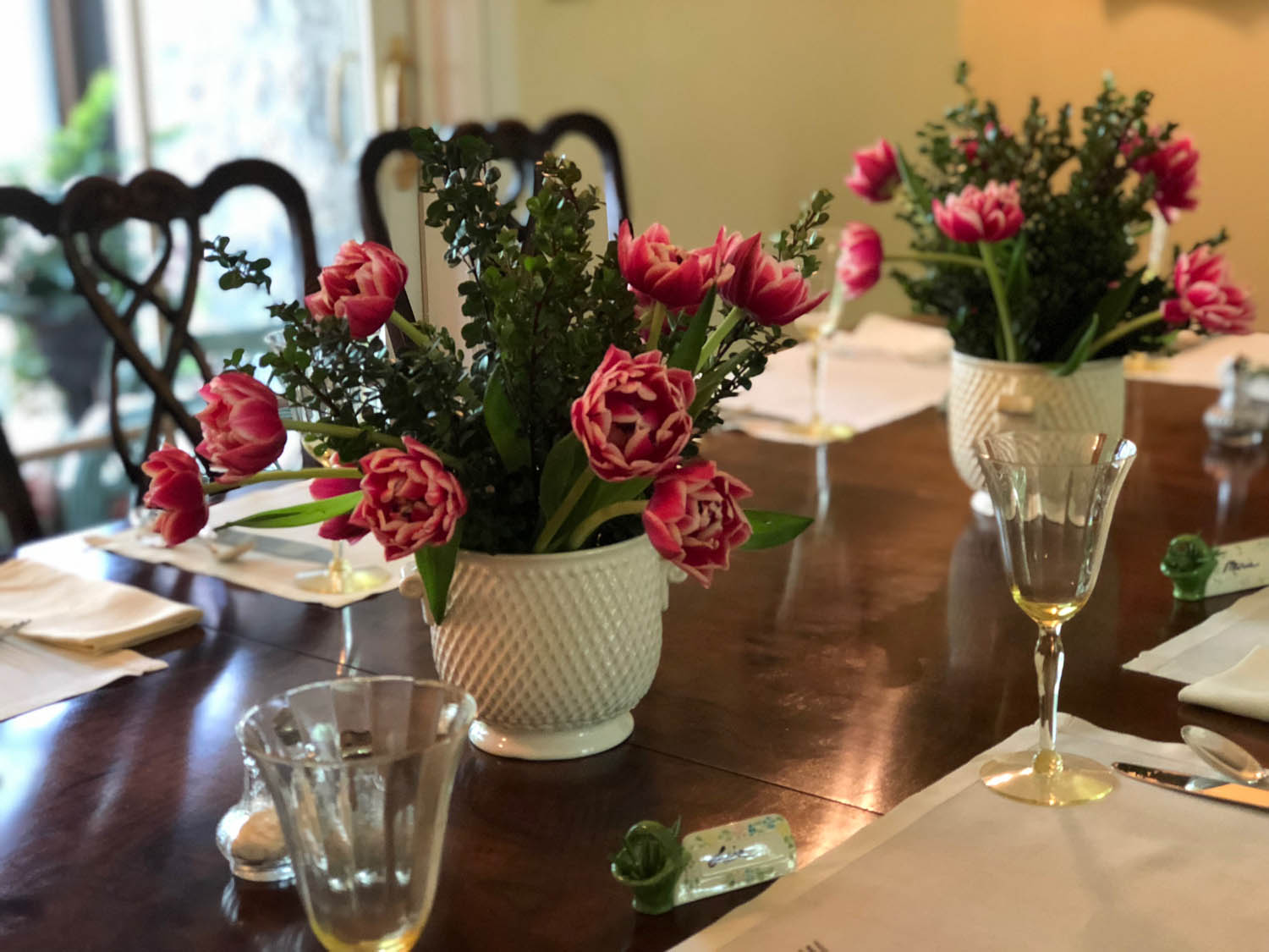 Dining table with floral arrangements and wine glasses