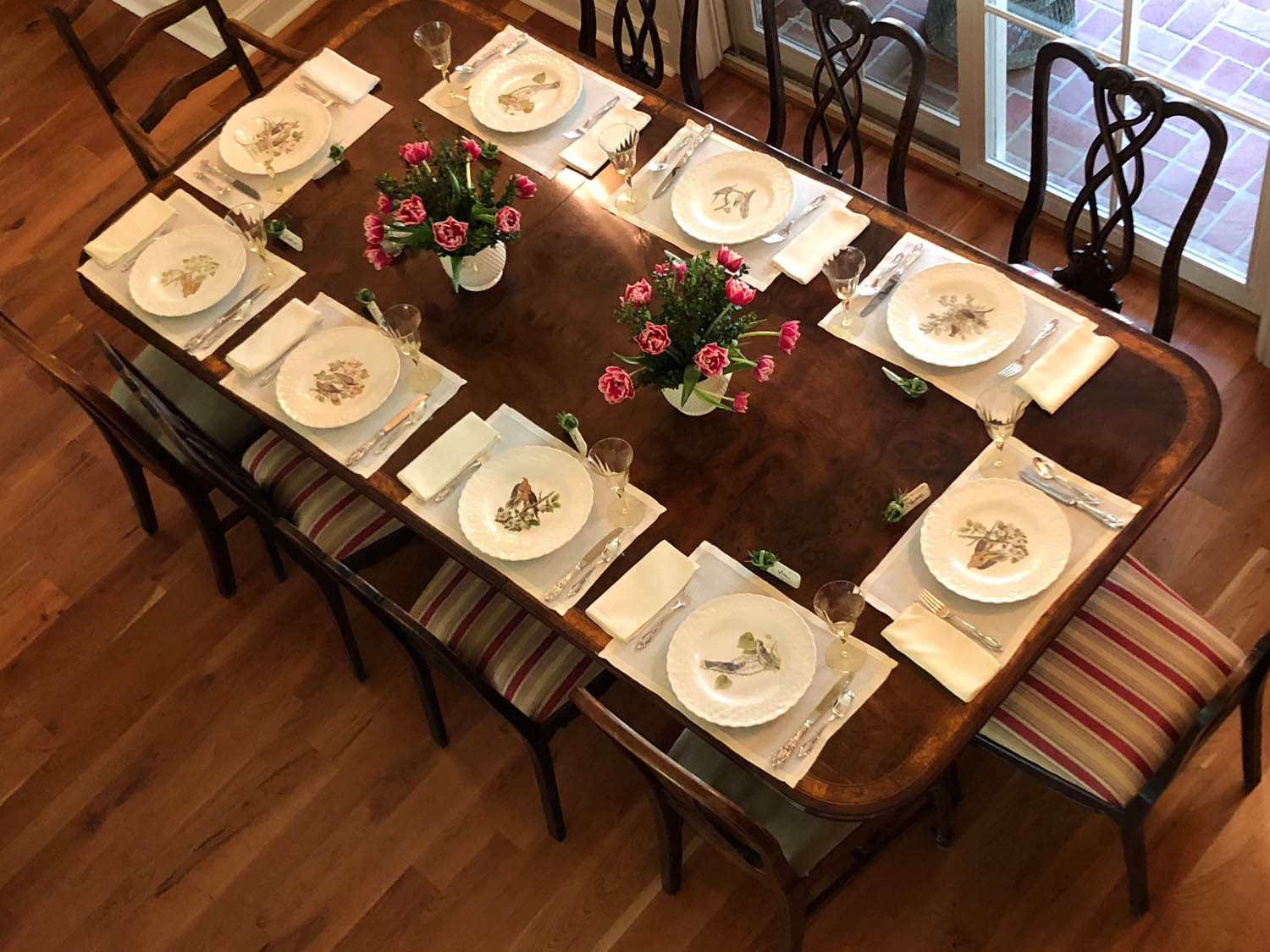 Overhead view of place settings at dining room table for Southern Ladies Lunch