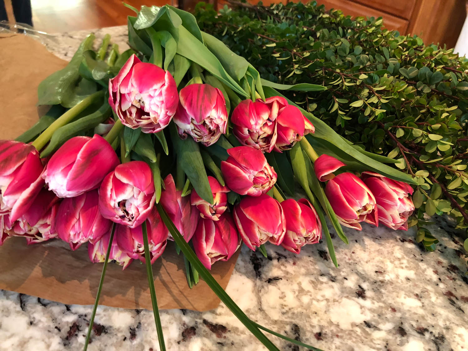 Bouquet of tulips and bundle of boxwood for floral arrangement