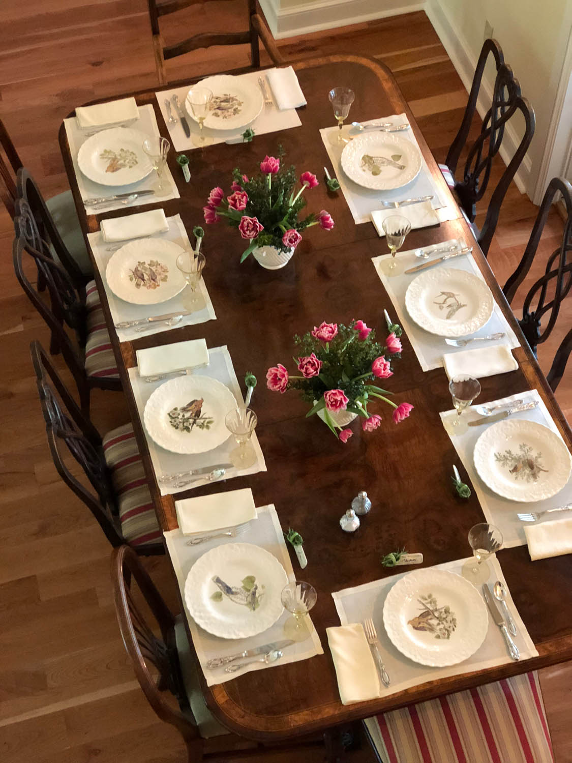Overhead shot of dining table with china place settings for souther ladies lunch