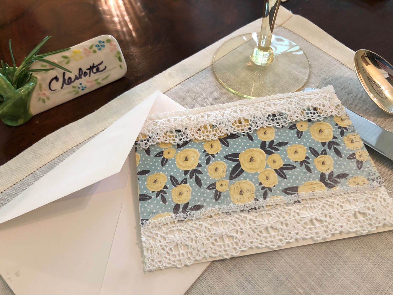 Handmade card embellished with vintage lace and fabric