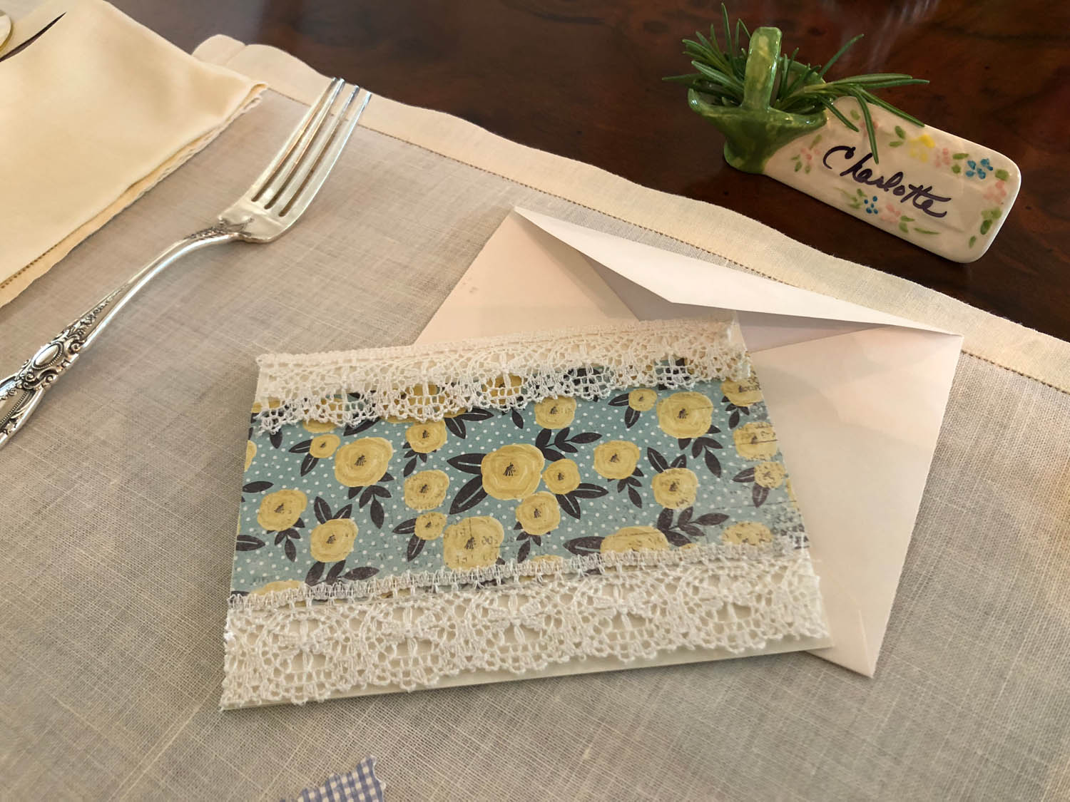 Finished hand-made card featuring vintage lace and fabric scraps