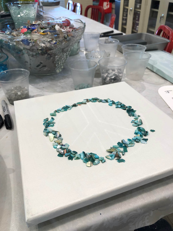 Beginning of peace sign glass artwork at The Shard Shop class