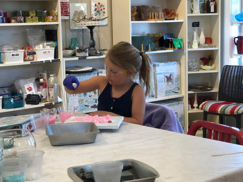 Children enjoying creating art at The Shard Shop classroom