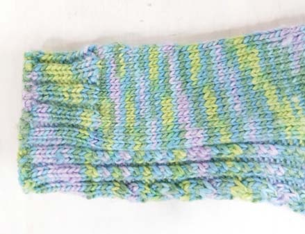 Cable Twist hand-knitted sock pattern cuff detail