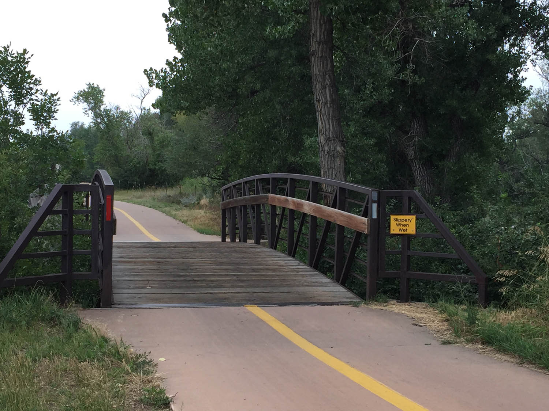 Small bridge along bike/walking path Platte River Trail in Littleton, CO