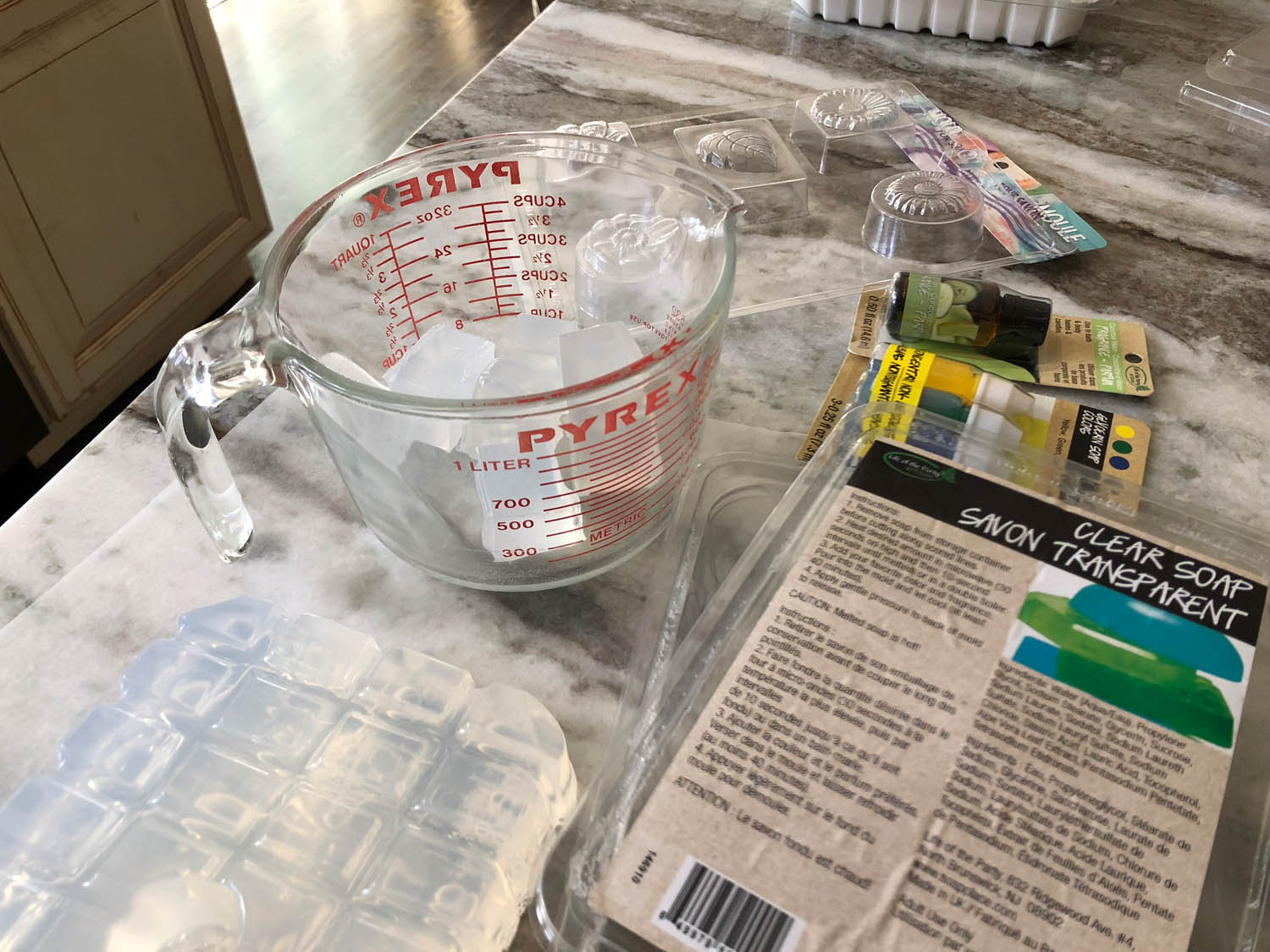 products for making clear soap and measuring cup to melt