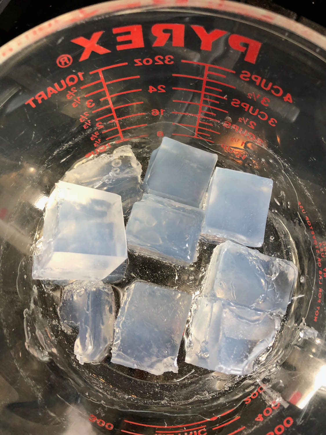 half way through melting soap in glass measuring cups