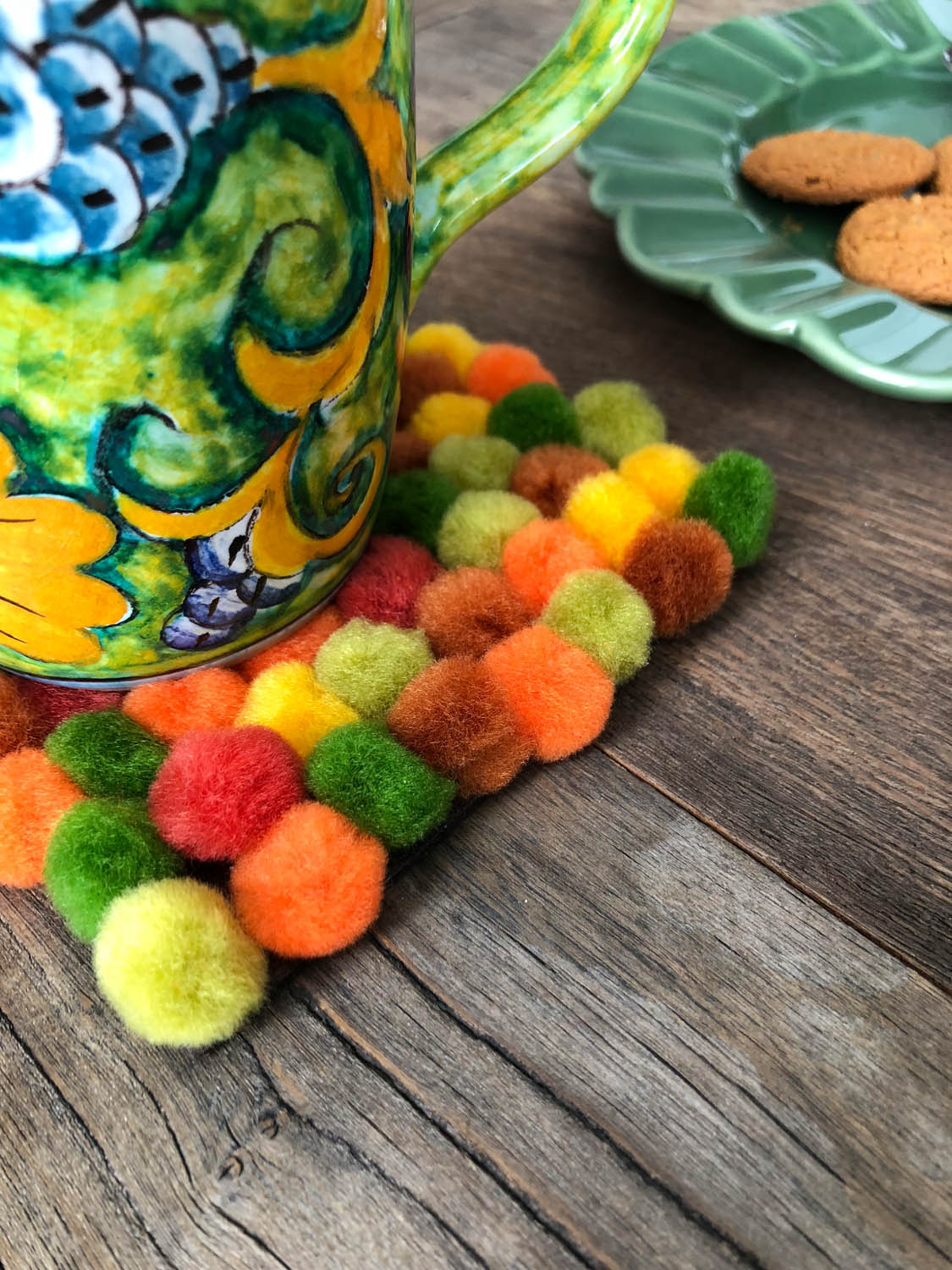 Pom-pom Coasters - Minimal supplies make this project easy and inexpensive, and it's fun for all ages! Use the same technique to make trivets and placemats.