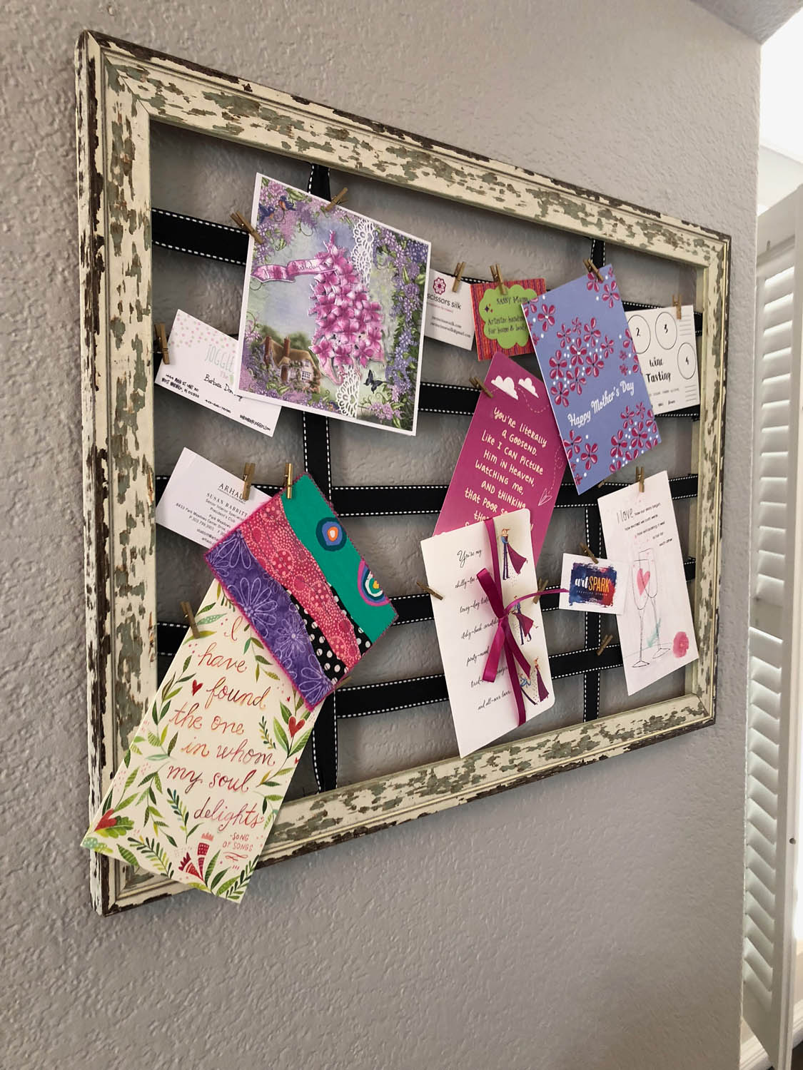 DIY clipboard from an old frame displaying greeting cards
