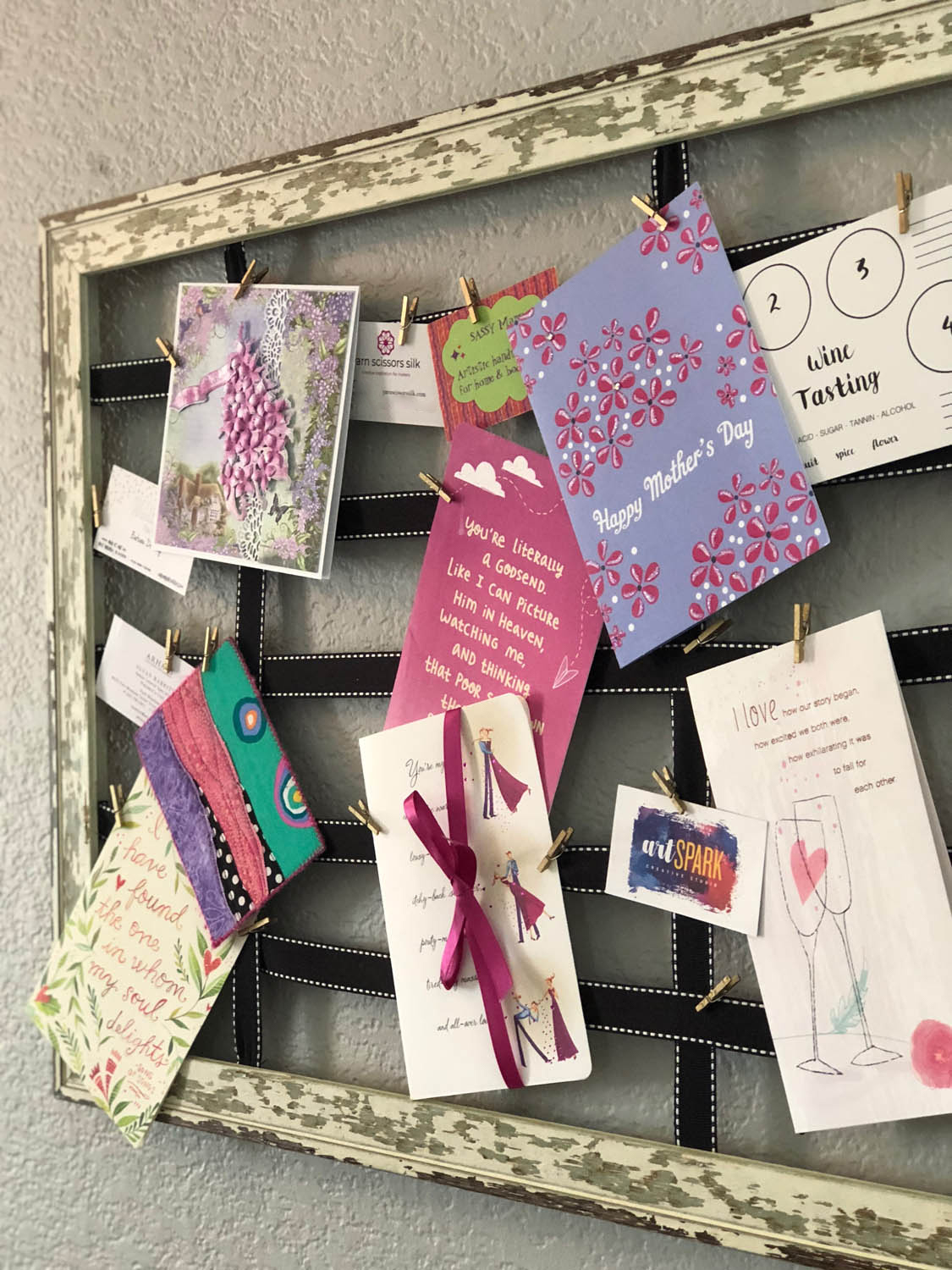7a-display-of-cards-clipped-to-ribbon-and-hanging-on-wall-v2.jpg