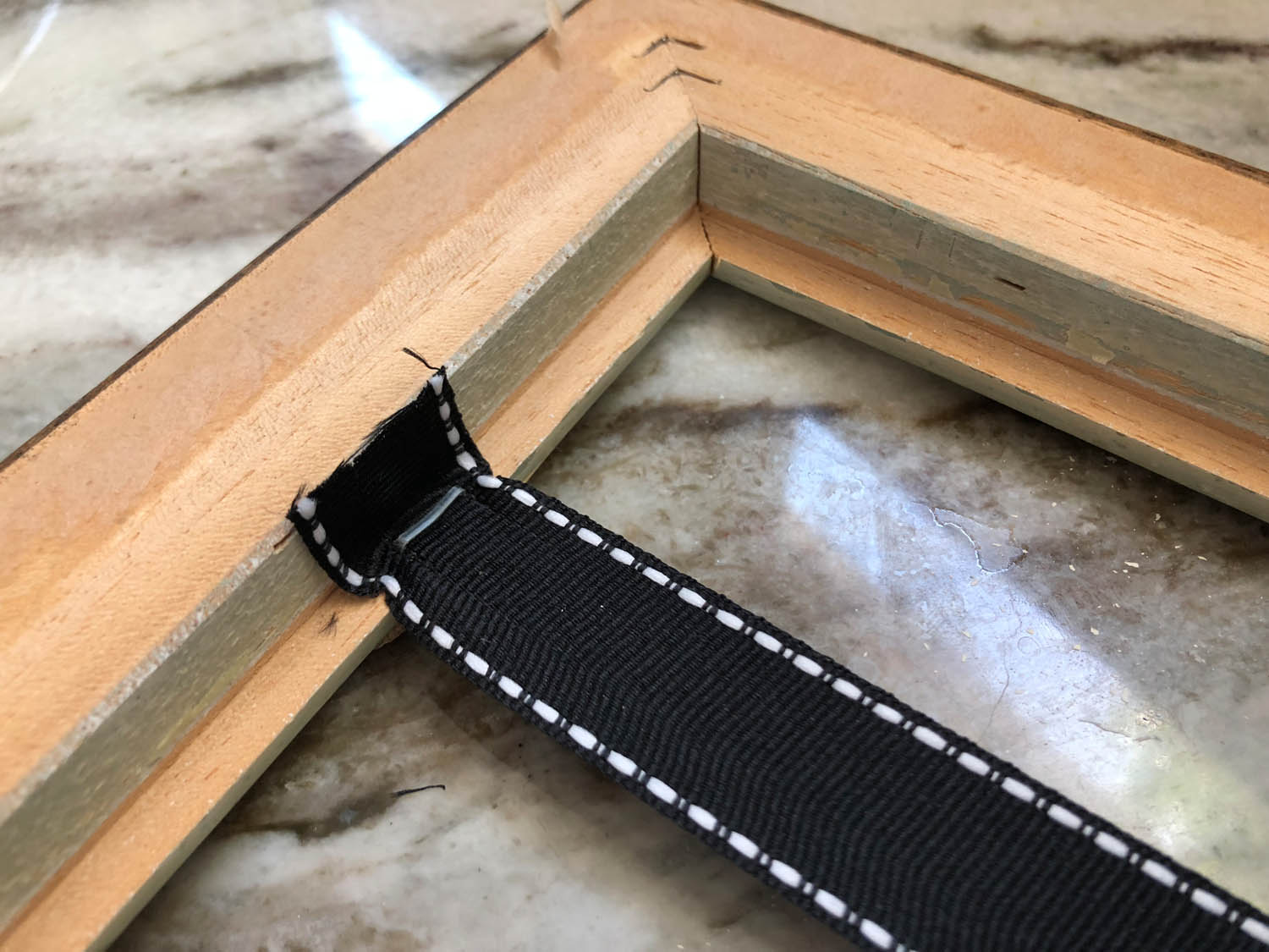 one length of ribbon stapled to DIY frame