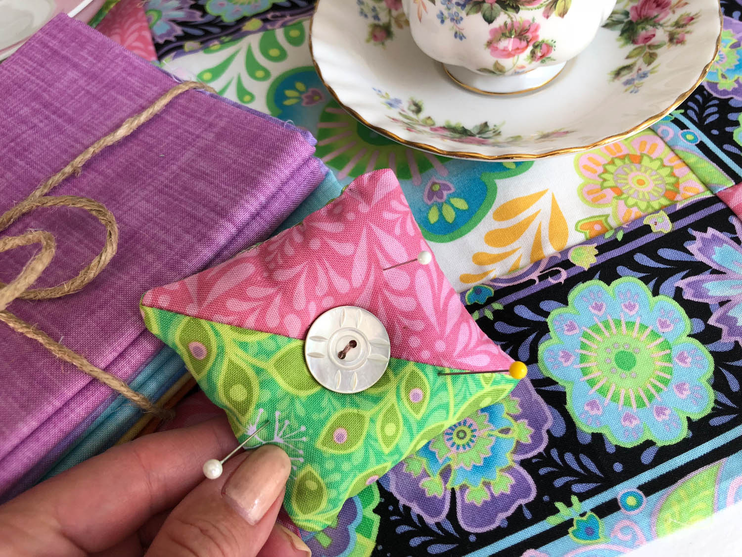 Simple Scrap Pin Cushions in A Few Easy Steps - Learn how to use fabric scraps or left over quilting units to make a simple pin cushion.