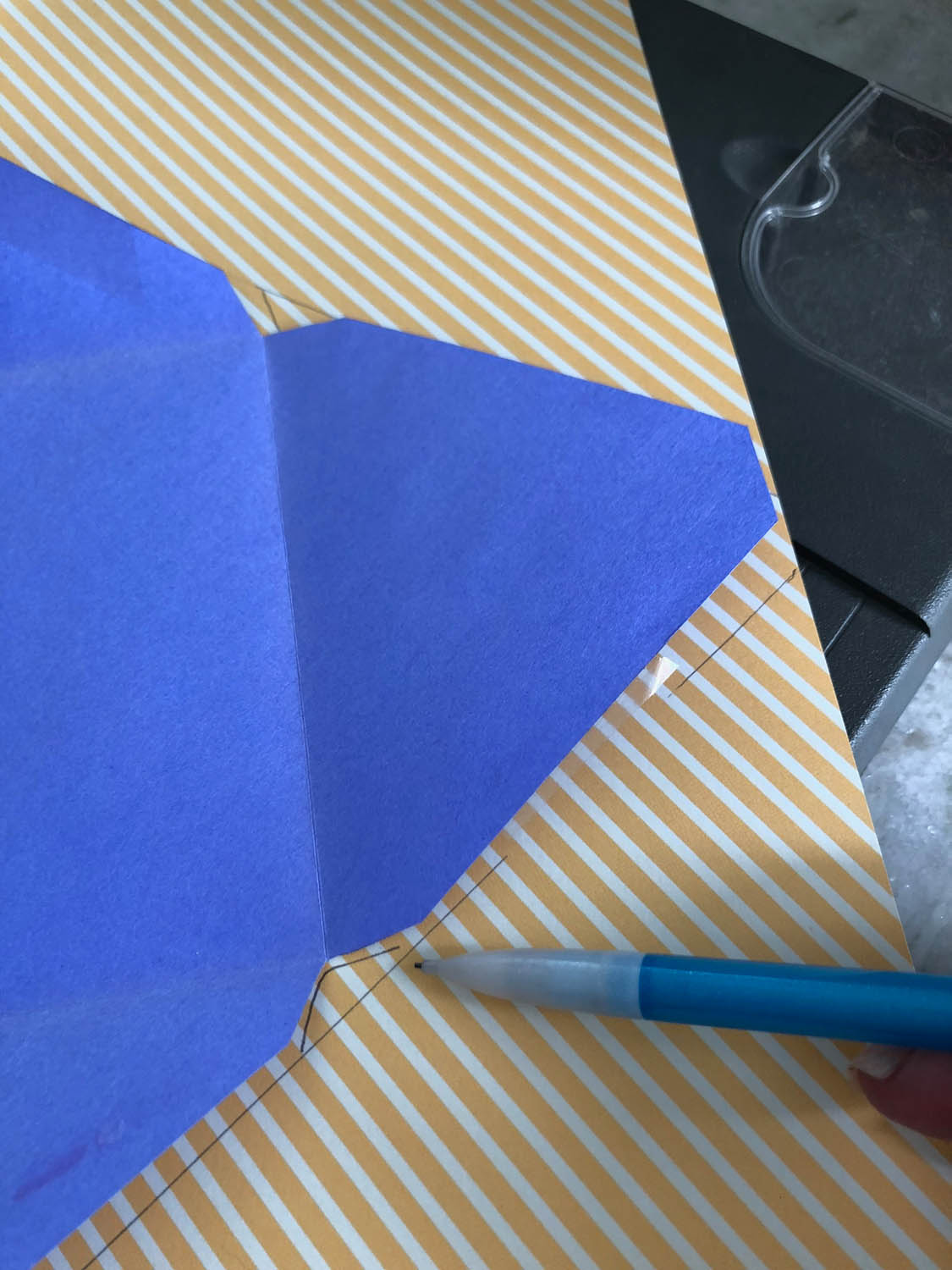 tracing on scrapbook paper for diy envelopes with scrapbook paper