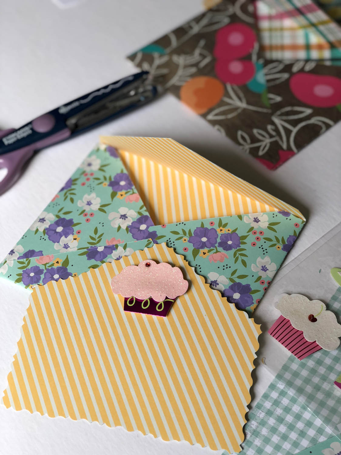 finished DIY envelopes with scrapbook paper and handmade birthday card