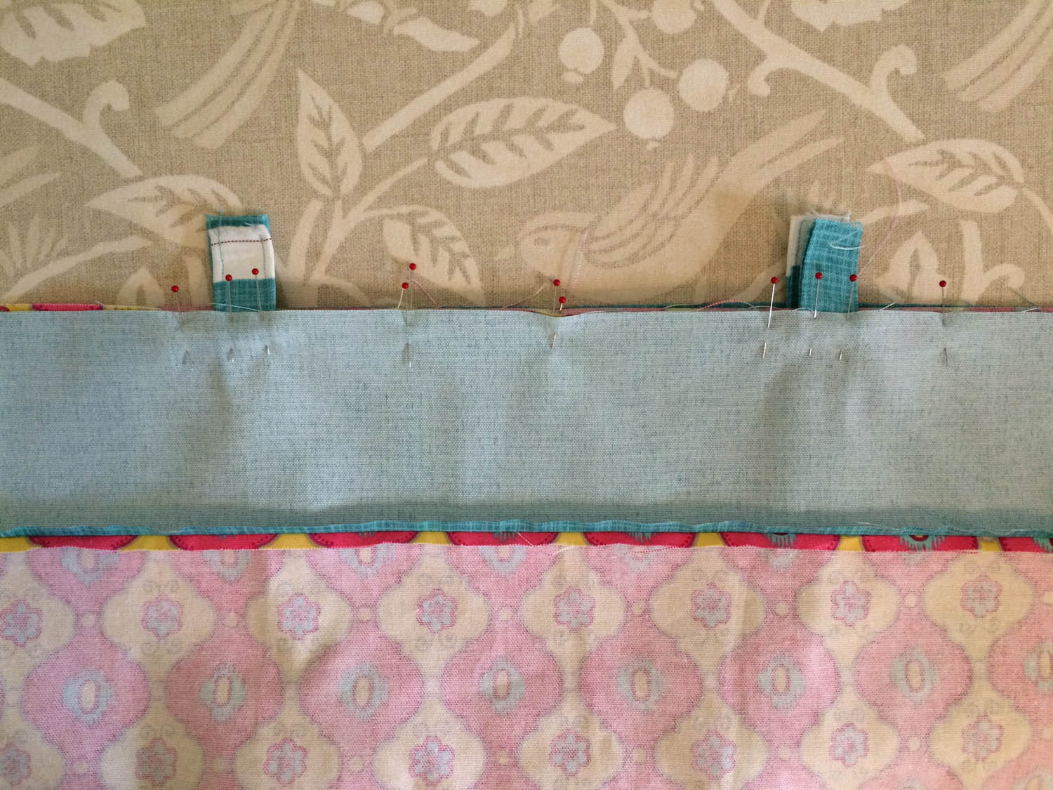 pinning outer tote to lining along top edge of tote