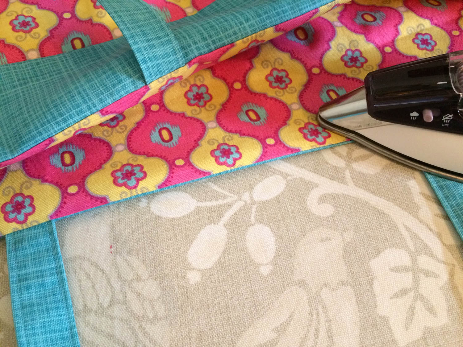 pressing the upper edge of the tote before edge stitching for a clean line
