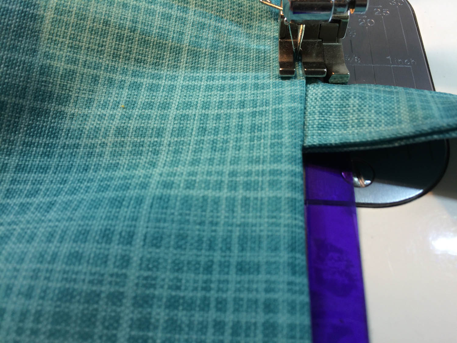 machine top stitching the edge of the tote