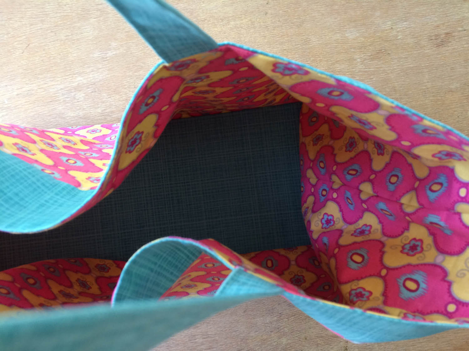 lined cardboard base inserted into tote