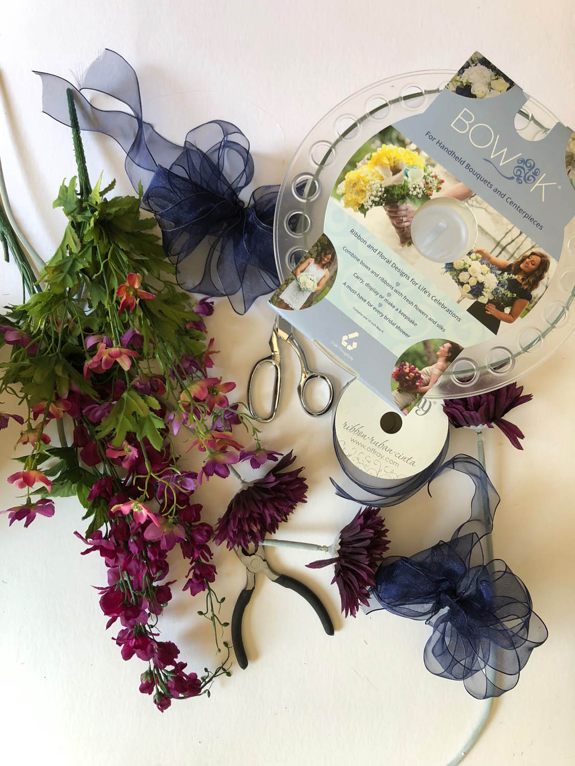 supplies to make simple centerpiece arrangements with ribbons and flowers