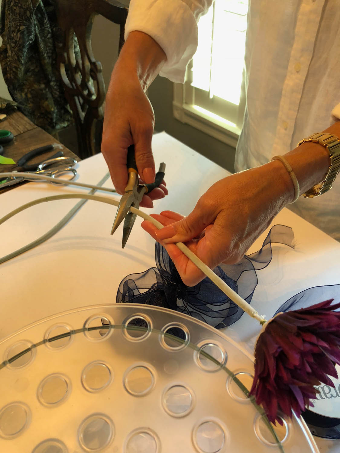 cutting wire stems of silk flowers for simple centerpiece arrangements