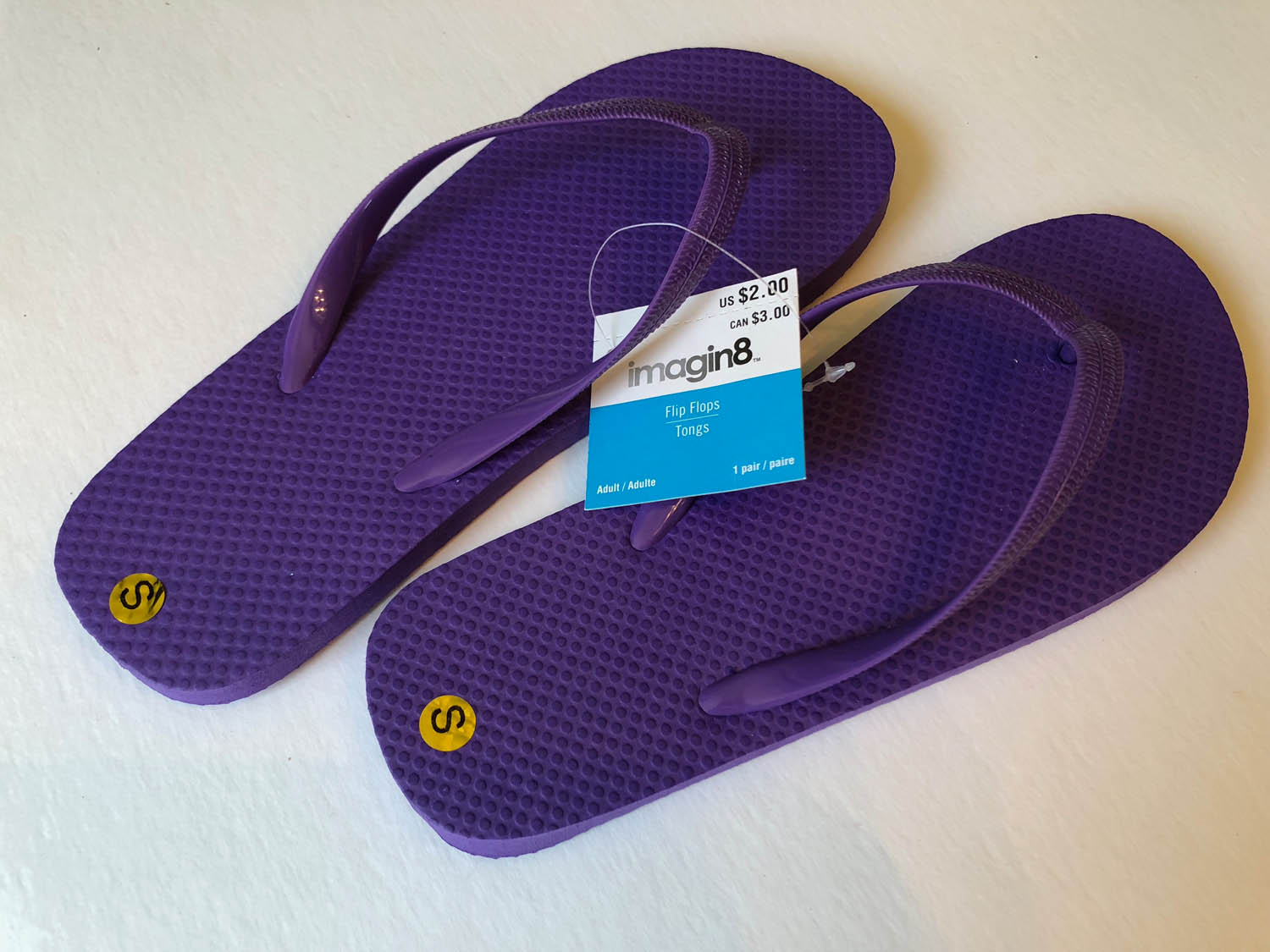 Purchased purple flip flops to embellish flip flops with silk flowers