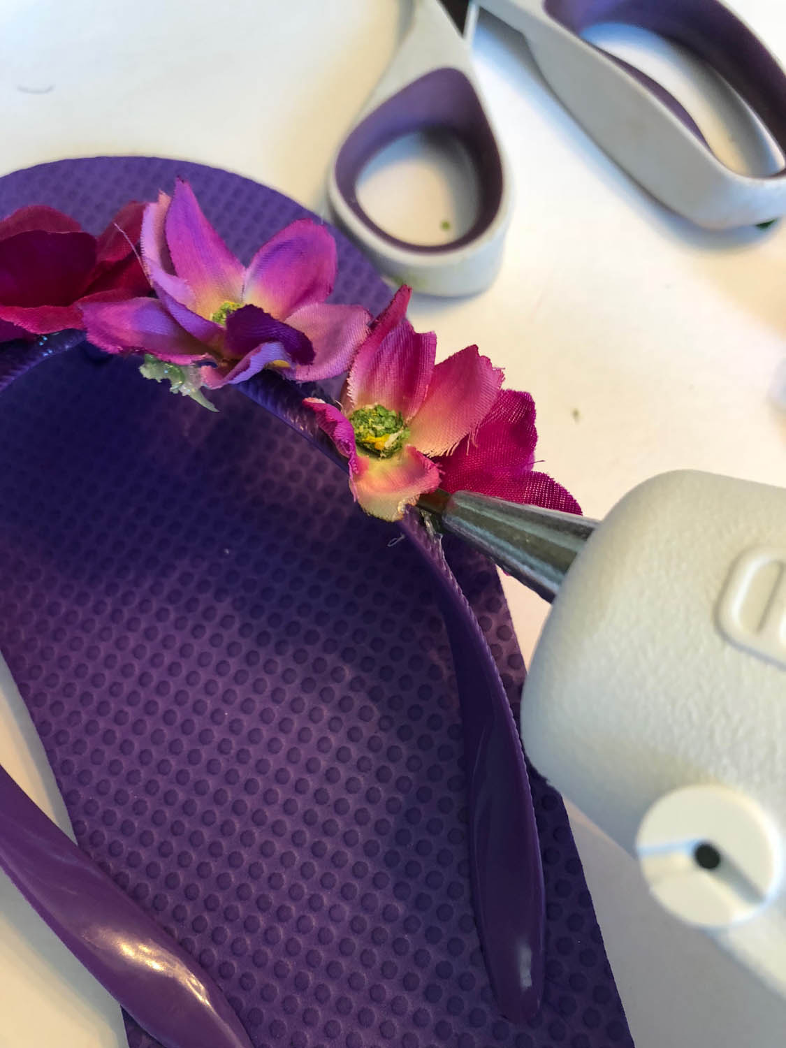 hot glue and silk flowers for how to embellish flip flops with silk flowers