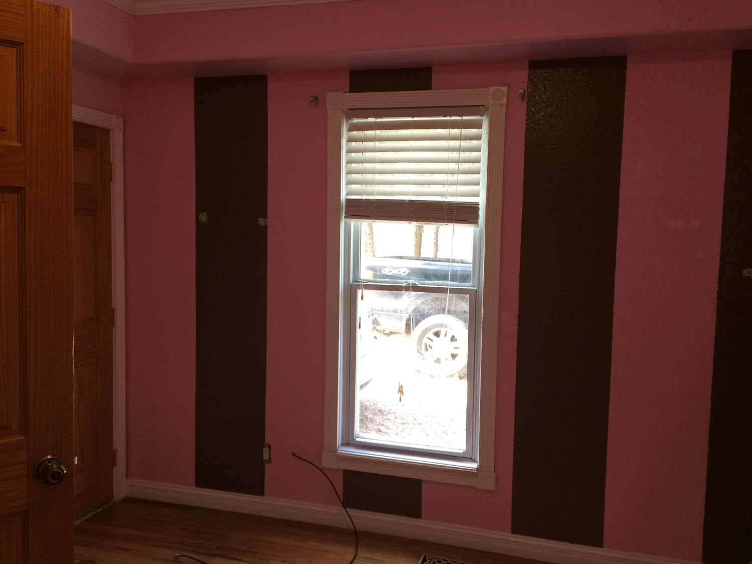 pink and brown wall stripes before painting blue