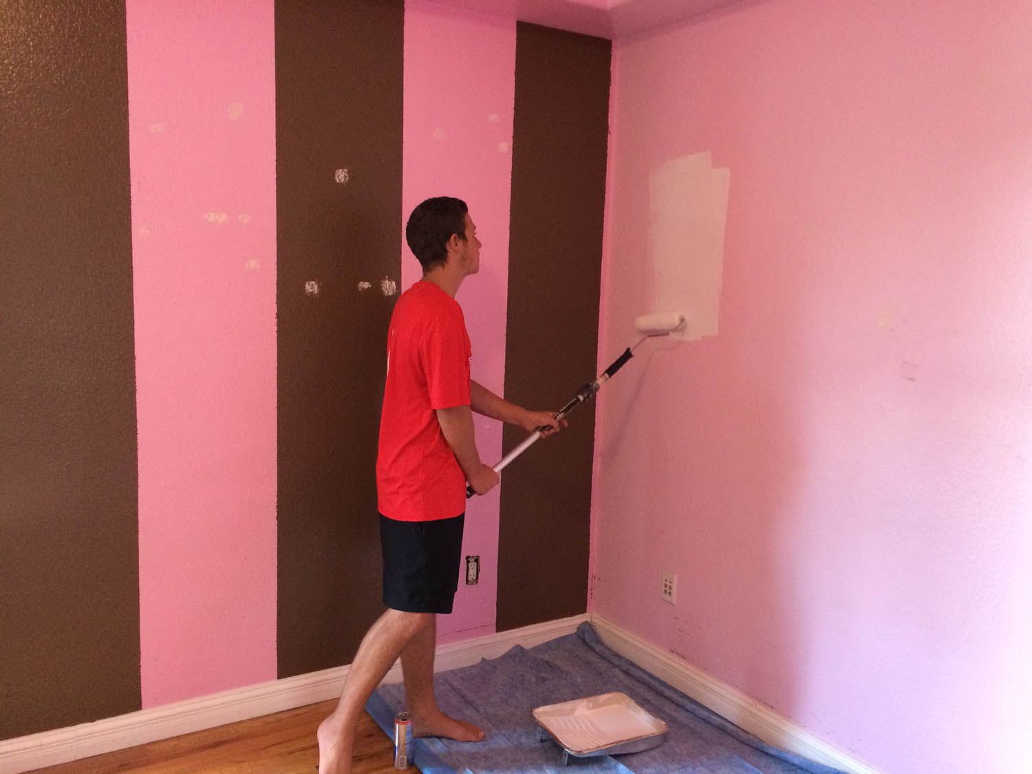 pink and brown wall stripes before repainting blue
