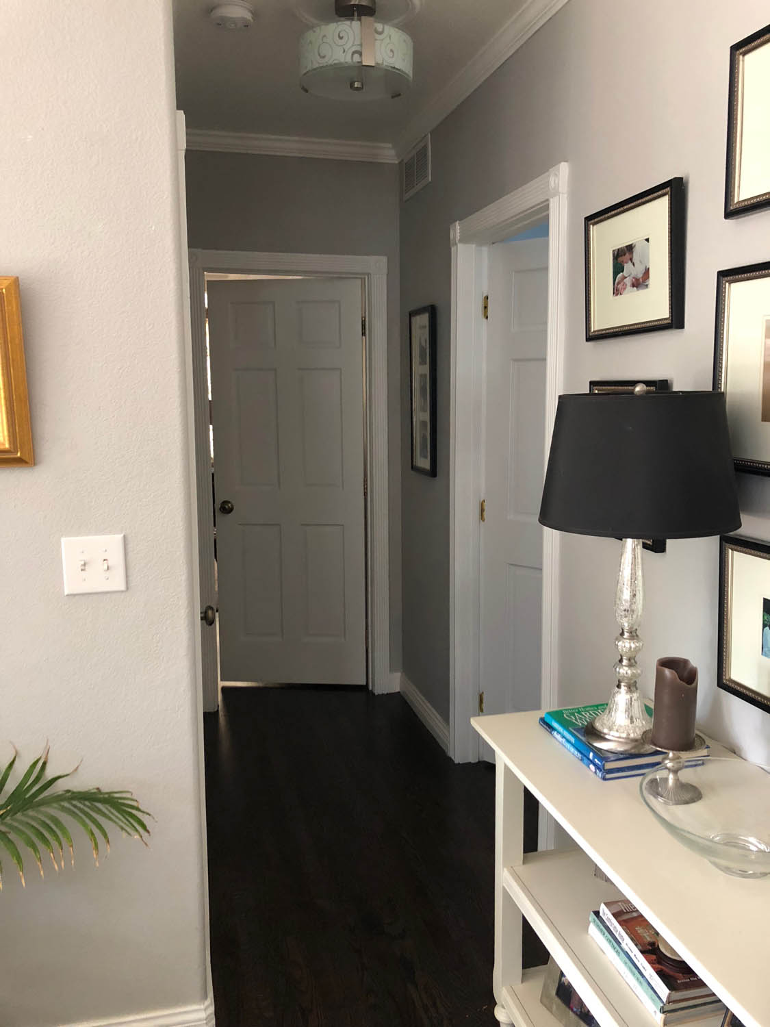 hallway after painting wood doors with white trim
