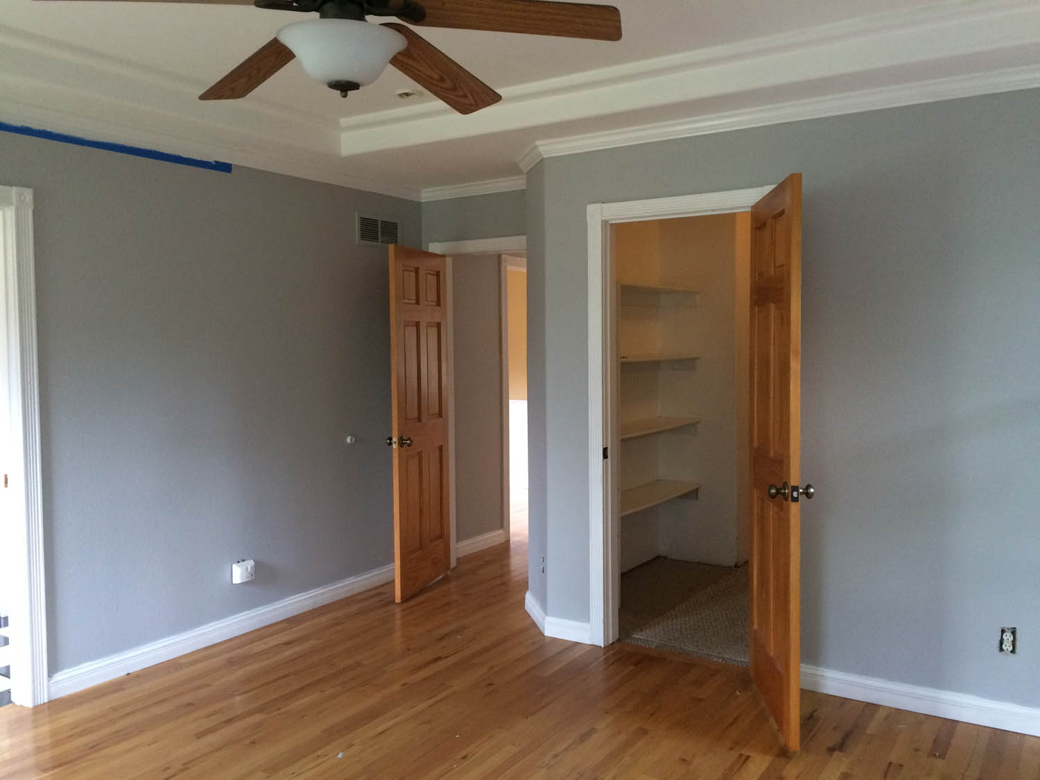 Master bedroom walls during painting and before doors painted.