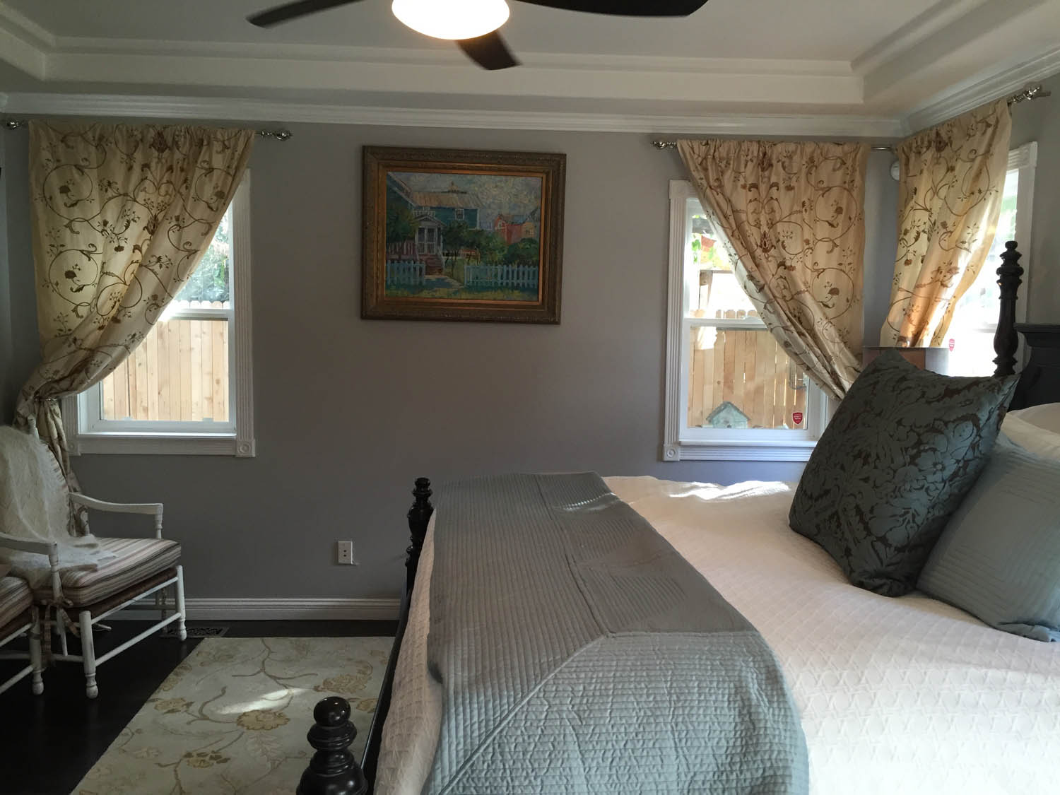 Another view of the master bedroom remodeled with new fan, floors, draperies and paint.