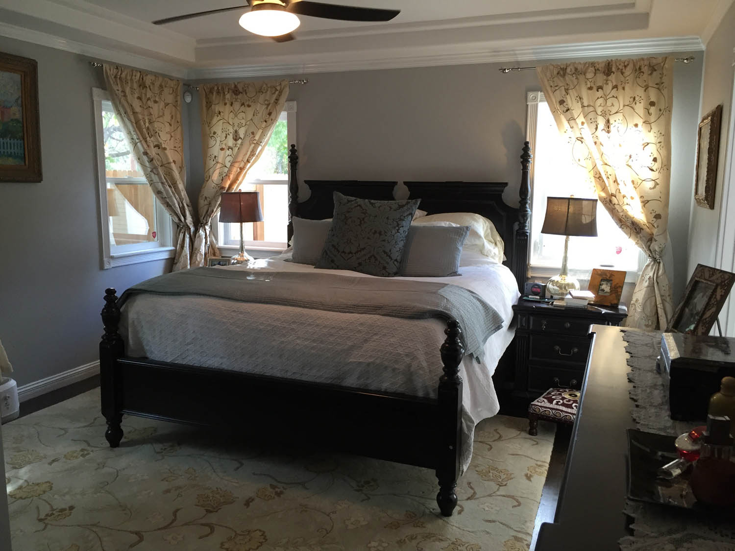 Master bedroom remodeled with new fan, floors, draperies and paint.
