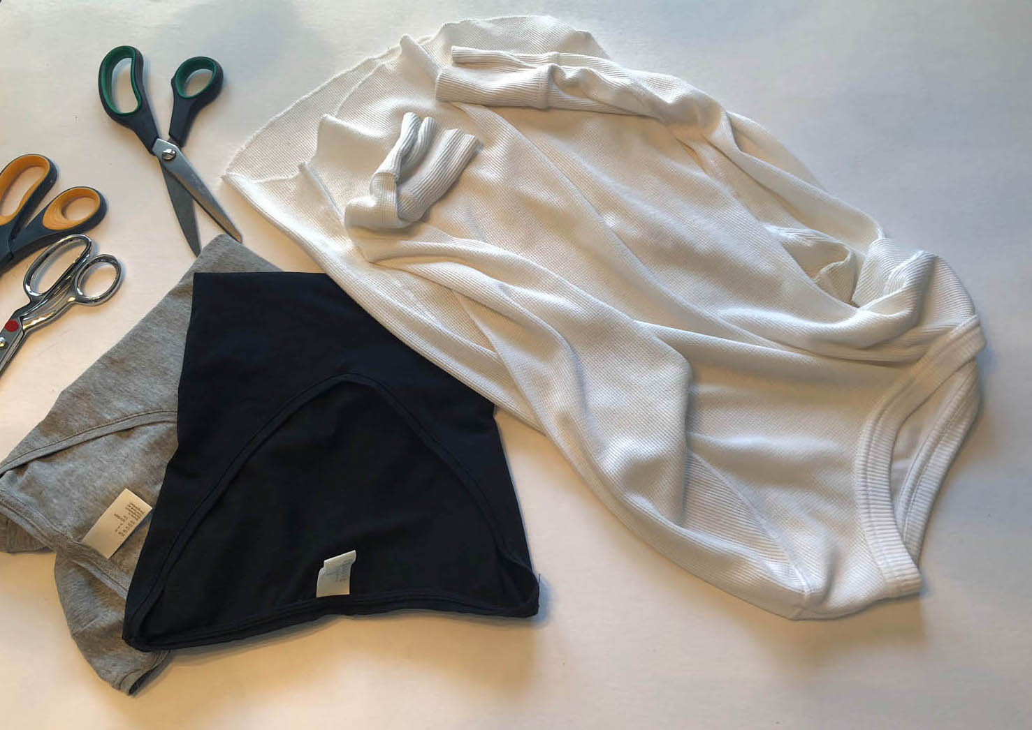 Trimming the hem and sleeves to make a fringed long sleeve t-shirt
