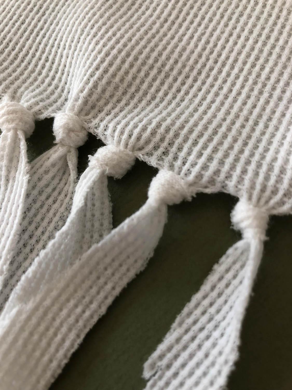 close up of fringe knots on long sleeve t-shirt