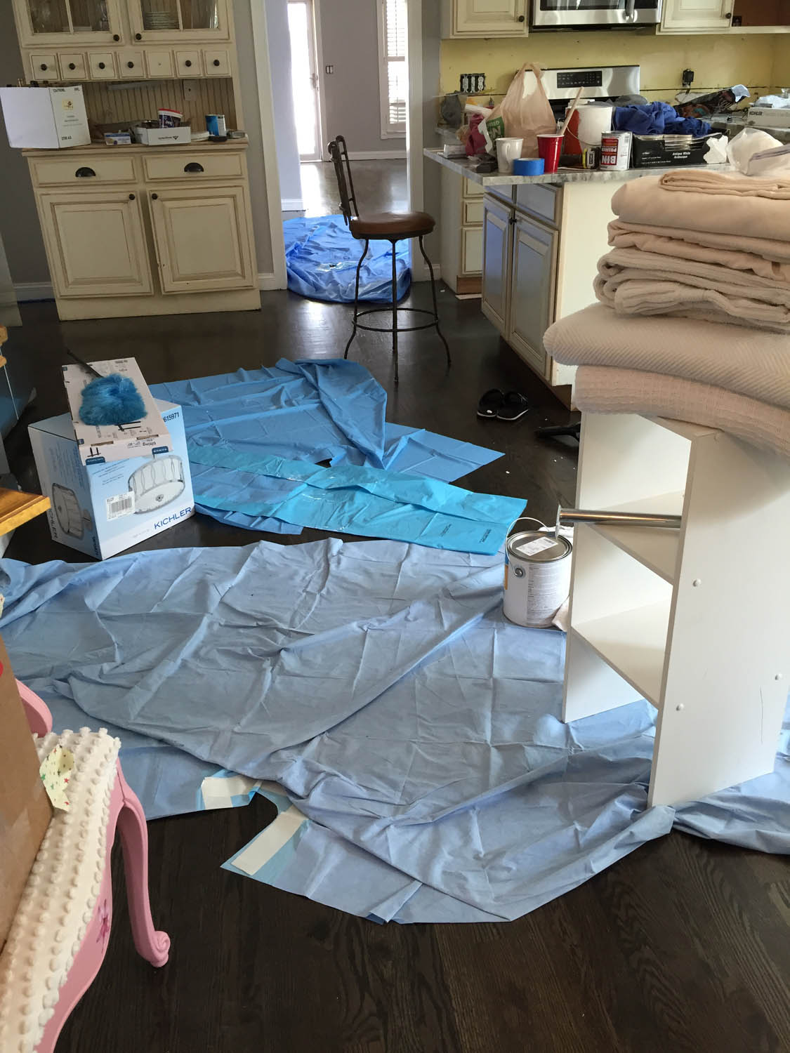 Several remodel projects at the same time, and always keeping the newly dark-stained floors covered.