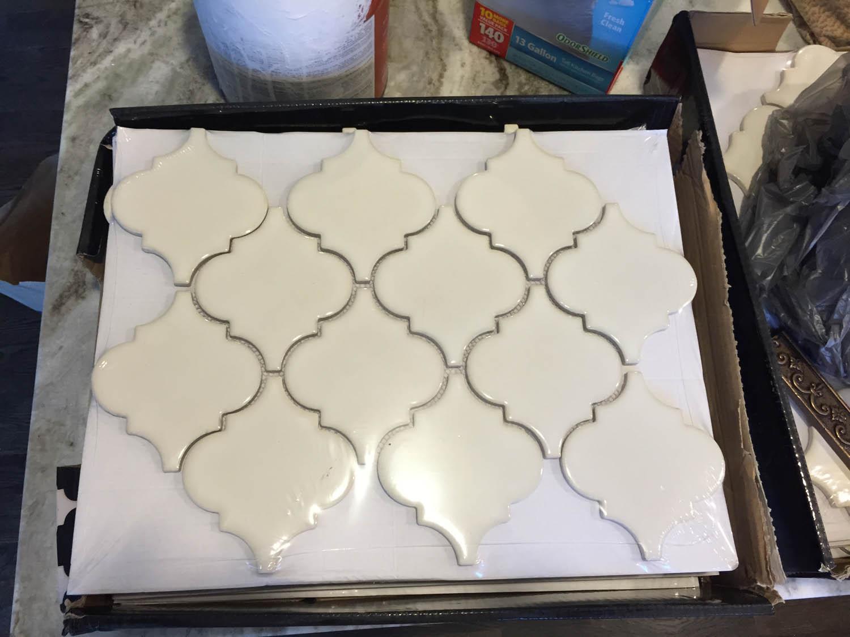 Off-white ogee tile for kitchen counter backsplash.