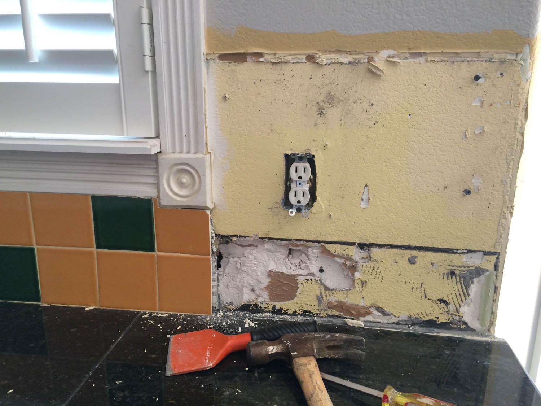 Old kitchen counter backsplash tile removal.