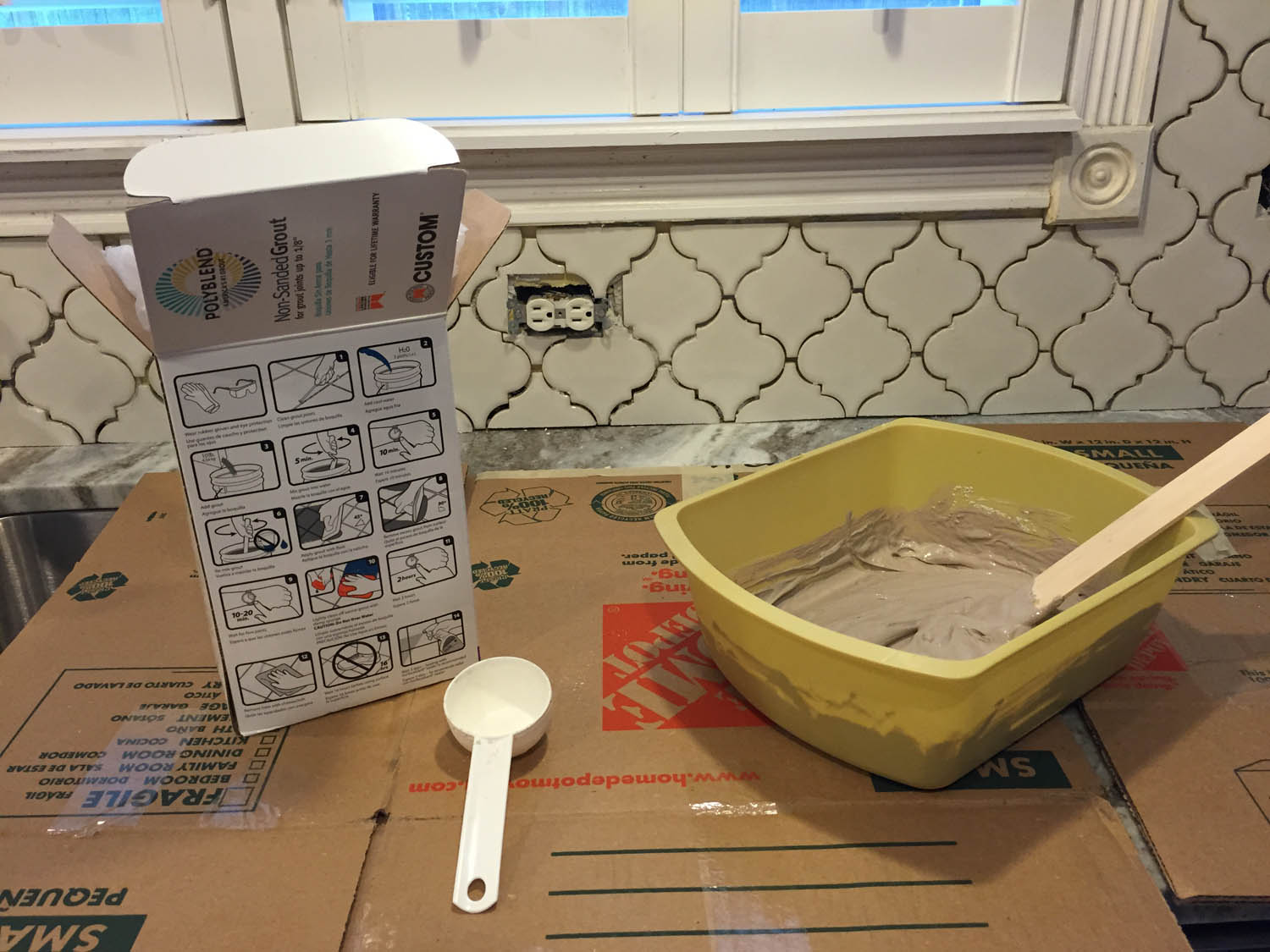 My Saturday project...grout the ogee tile backsplash.