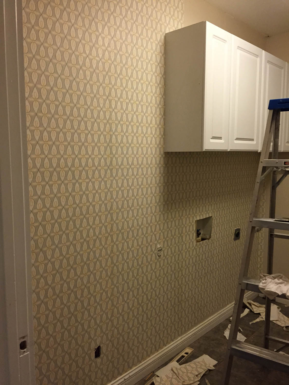Wallpapering the laundry room piece by piece
